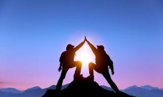Two climbers high 5 rock