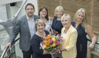 Wendy Smith from the community engagement team receives a bouquet from Professor Liz Kay, with Robert Witton, Karen Burns, Nicola Brown and Claire Kenyon