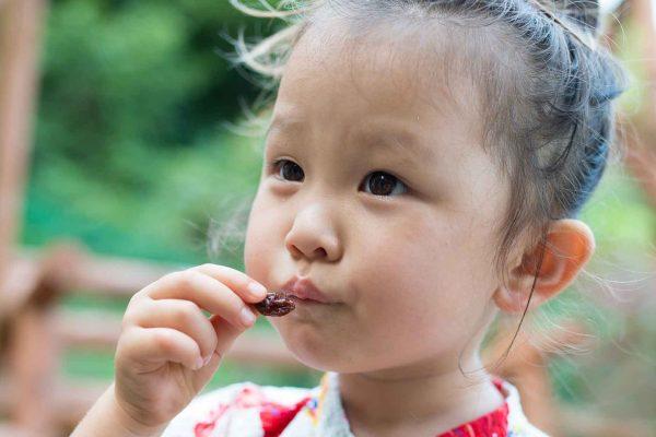 school girl eating raisins