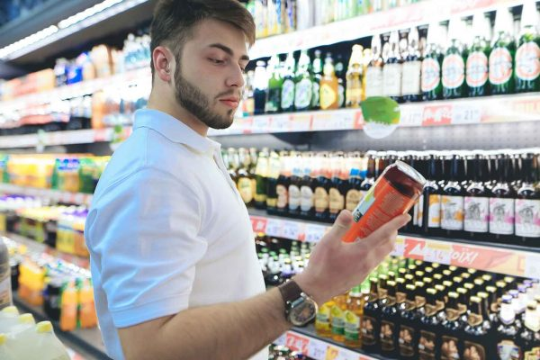 Man looking at alcoholic drinks