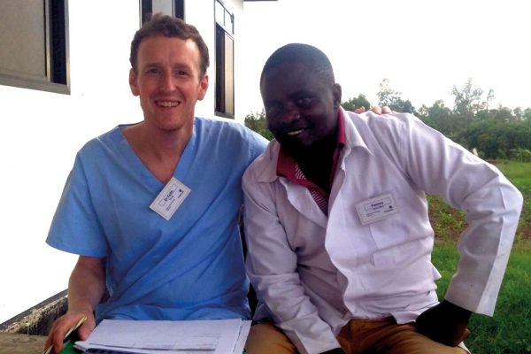 Keith McClean with a health worker during his visit to Tanzania with charity Bridge2aid