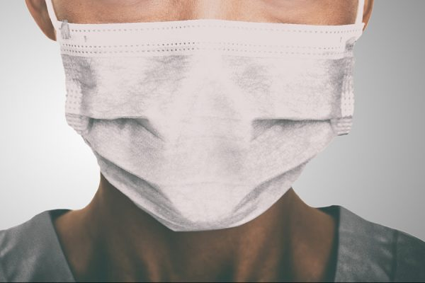 Dentist wearing protection during COVID-19