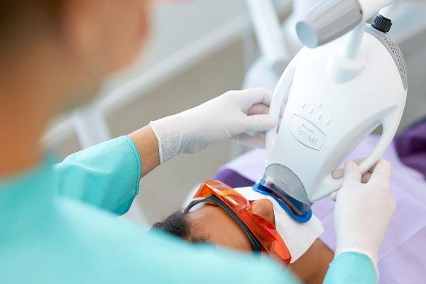 patient having Philips zoom teeth whitening