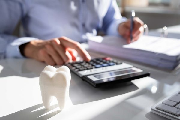 dentist working out finances for restart