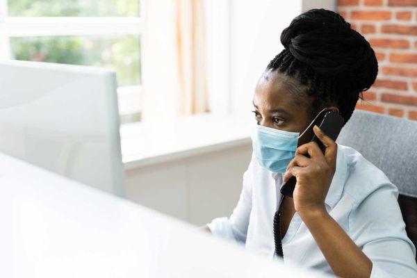 dental receptionist wearing face masks