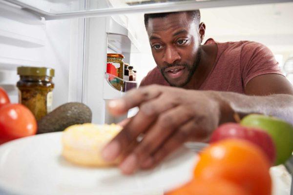 snacking in fridge