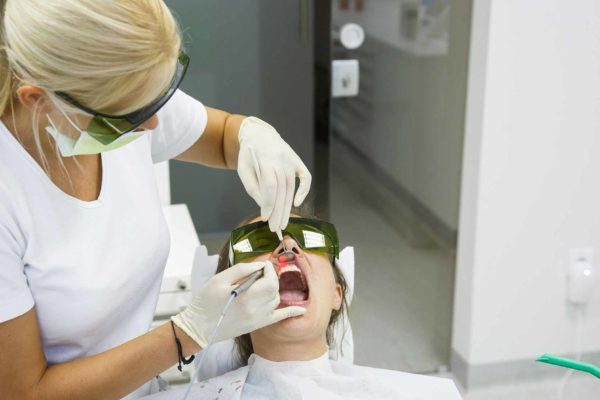 dental therapist working on patient