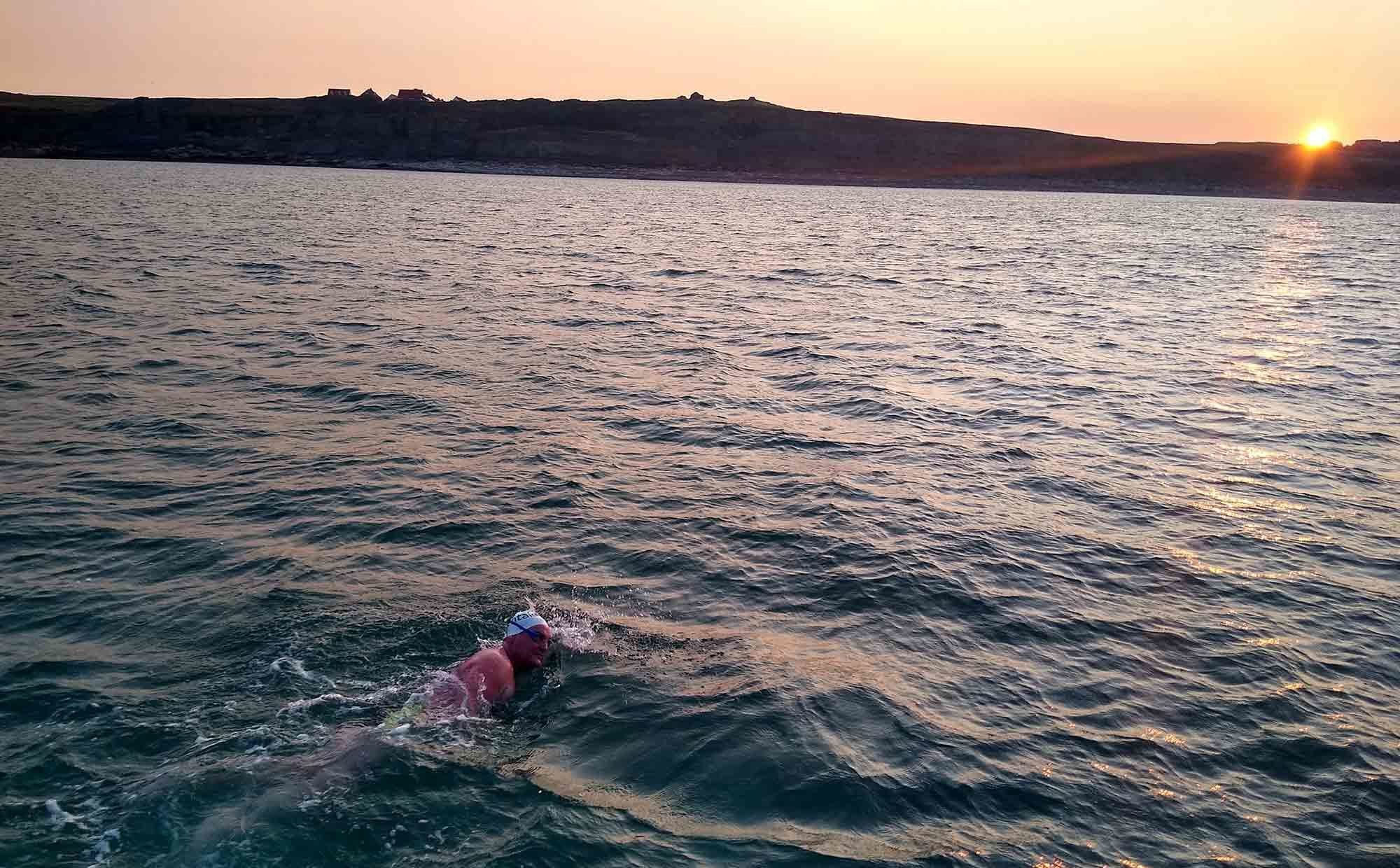 A dentist who braved a solo swim across the English Channel raised almost £7,000 for a dental charity