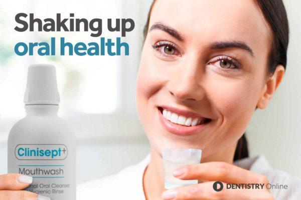 woman using Clinisept+ Mouthwash