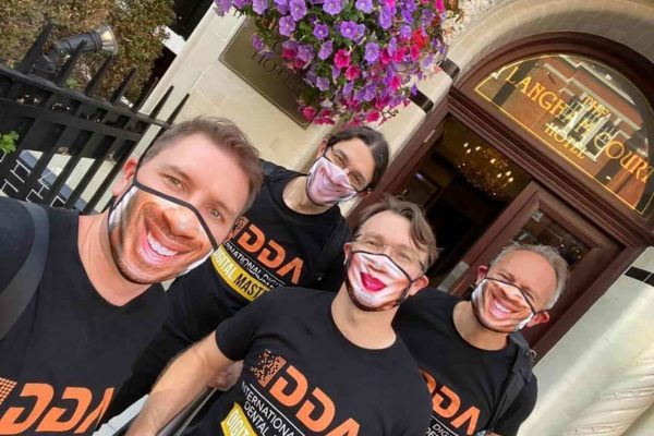 A dentist is making customised face masks and gowns in a bid to cut plastic waste and raise money for charity