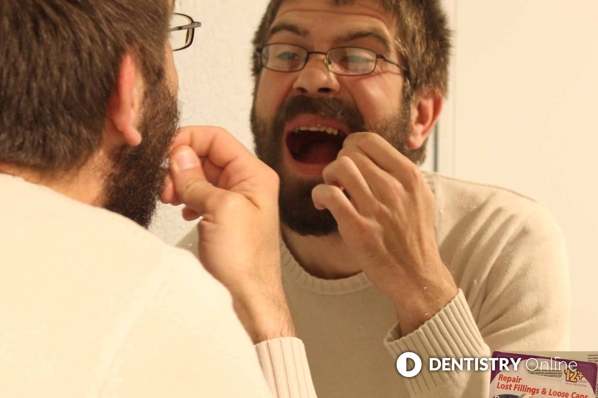 man carrying out diy dentistry