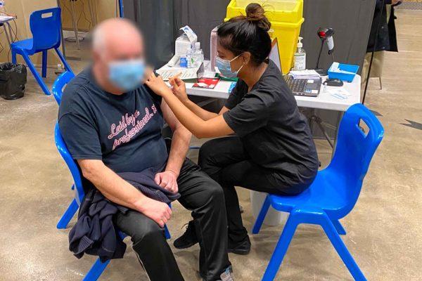 Giving covid vaccine