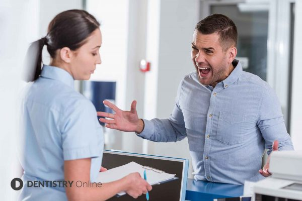 difficult patients talking to receptionist