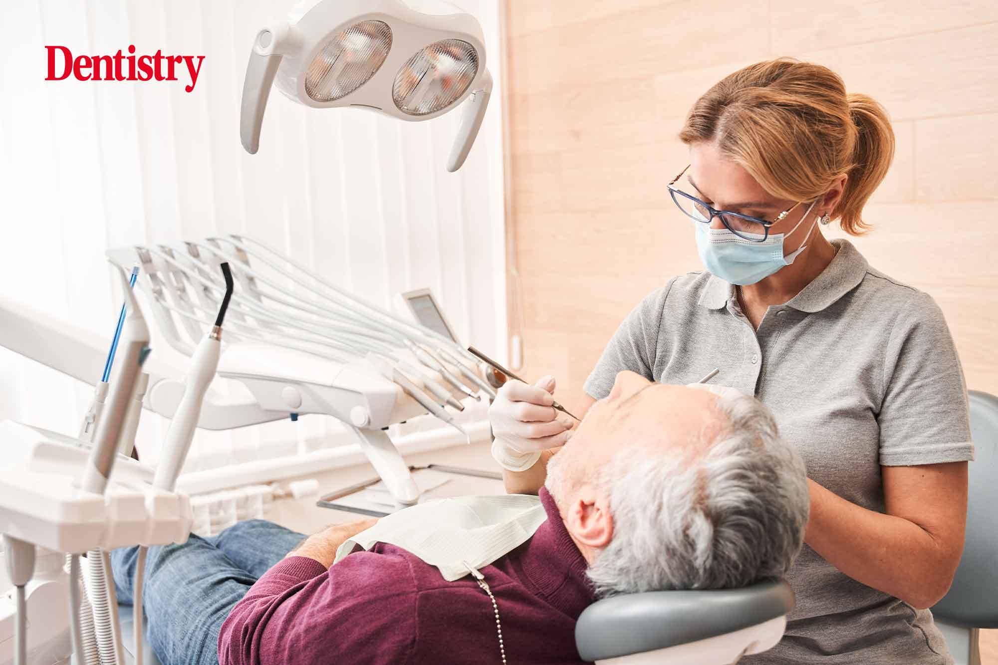 dentist checking for oral cancer